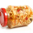 Preserved cabbage and red paprika salad in glass jar — Stock Photo #38960283