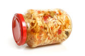 Preserved cabbage and red paprika salad in glass jar — Stock Photo