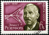 USSR - 1971: shows Ernest Rutherford (1871-1937) and Diagram of Movement of Atomic Particles — Stock fotografie