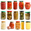 Selection of various vegetables canned in glass jars — Stock Photo