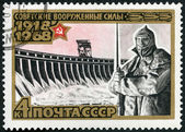 """USSR - 1968: shows Dneprostroi Dam and sculpture """"On Guard"""", series 50th anniversary of the Armed Forces of the USSR — Stock Photo"""