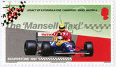 """JERSEY - 2013: dedicated Nigel Mansell, Mansell on the victory lap at the 1991 British Grand Prix gives Artyon Senna a lift to the paddock, """"Legacy of a Formula One champion - Nigel Mansell"""" — Stock Photo"""