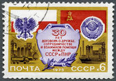 USSR - 1975: shows Flags and Arms of Poland and USSR, Factories, devoted Treaty of Friendship, Cooperation and Mutual Assistance between Poland and USSR, 30th anniversary — Foto de Stock