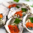 Royalty-Free Stock Photo: Oysters with red caviar