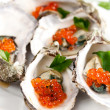Oysters with red caviar — Stock Photo #12610896
