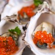 Oysters with red caviar - Stock Photo