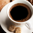 White cup of coffee with brown sugar — Stock Photo