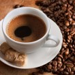White cup of coffee with brown sugar — Stockfoto