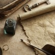 Photo: Antique paper scroll , quill pen and compass