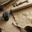 Foto Stock: Antique paper scroll , quill pen and compass