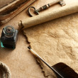Stock Photo: Inkwell and quill on vintage paper background