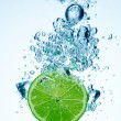 Lime dropped in a water — Stock Photo