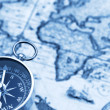 Old fashioned compass and vintage map — Stock Photo