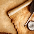 Antique paper scroll , quill pen and compass — Photo