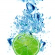 Lime in spray of water — Stock Photo #12616336