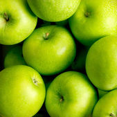 Green apples background — Stock Photo
