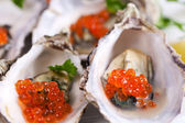 Oysters with red caviar — Stock Photo