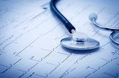 Stethoscope on the cardiogram — Stock Photo