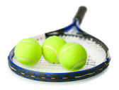 Tennis racquet with yellow tennis balls — Stock Photo