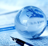 Glass globe on business table — Stock Photo
