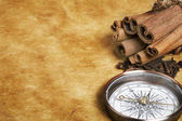 Compass and spices — Stock Photo