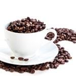 pohár plný kávová zrna — Stock fotografie