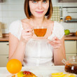 Young beautiful happy woman with tea - Stock Photo
