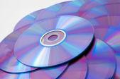 Sfondo di alcuni compact disc colorati — Foto Stock
