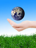 Hand holding earth, saving earth concept. — Stock Photo