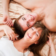 Young happy couple in bed — Stock Photo #20194293