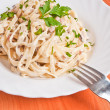 Spaghetti . Fettuccine carbonara in a white bowl, garnished with — Stock Photo