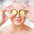 Woman with cucumbers on eyes — Stock Photo #20194697