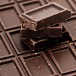 Stock Photo: Chocolate pieces on white