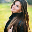 Young woman portrait in autumn park — Stock Photo