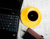 Notebook, cup of coffee and office supplies. — Stock Photo