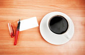 Blank card with pencil on coffee cup — Stock Photo