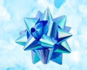 Blue ribbon on background of holiday lights — Stock Photo