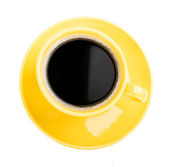 Coffee in an yellow cup — Stock Photo