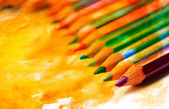 Color photo of a set of pencils on watercolor — Stock Photo