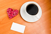 Red straw heart and cup of coffee — Stock Photo