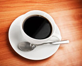 Cup of coffee on table — Stockfoto