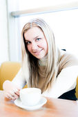 Blond woman drinking coffee — Stock Photo