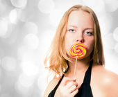 Woman and sweet sugar candy — Stock Photo