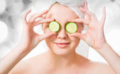 Woman with cucumbers on eyes — Stock Photo