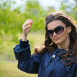 Woman in blue jacket in green summer park — Foto de Stock