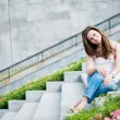 Portrait of a beautiful european woman sitting om steps — Lizenzfreies Foto