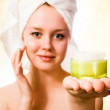 Young girl with towel on her head and cream. — Stockfoto #21572769