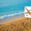 No swimming sign on a beach — Stock Photo
