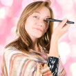 Pretty woman applying make up. — Stock Photo
