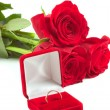 Stock Photo: Roses and wedding ring